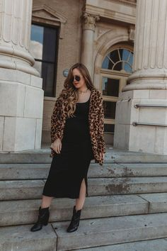 Edgy date night outfit styled with black stretch midi dress, leopard coat, and black ankle booties #datenightoutfit #leopardcoat #blackbooties