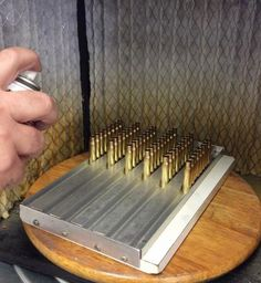 AMU method for quickly applying sizing lube to cartridge cases. Reloading Brass, Reloading Data, Reloading Room, Reloading Equipment, Shooting Guns, Shooting Range, Shooting Sports, Shooting Targets, Home Design