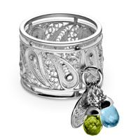 This remarkable sterling silver ring  is made by using a Filigree double thread technique of  northern Peru. The knitting and threading of silver filaments creates the appearance of  lace. Three gems combined; Peridot, Blue Topaz and White Topaz creates a beautiful accent cluster.  This ring is part of the Virreyna collection. #silver #silver ring