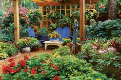 Use an outdoor room, like the space under a pergola, as a place to mix your containers. This grouping has a lush, vibrant mix of planters and hanging pots.