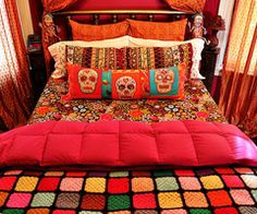 cute skull bed.....love the vintage afghan...takes me back to the days visiting my grandpa and grandma harder