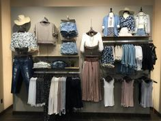 Clothing is much more interesting displayed on a variety of levels, like this wall, highly planned to hold a volume of merchandise while giving full front display to several featured items.