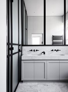 Black and white bathroom marble counter under mount sink