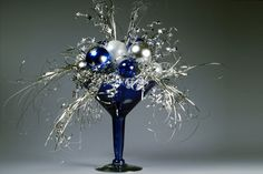 easy new years decor idea...take clearance Christmas ornaments in midnight blue/silvery colors, put in some silver garland & place in a tall martini glass or candle holder