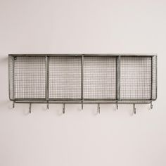The mix of galvanized metal and mango wood on our wall unit exudes industrial appeal. This entryway accessory features four cubby bins, a top shelf and a row of hooks for ample storage.