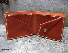 Billetera artesanal fabricada en ternera engrasada.