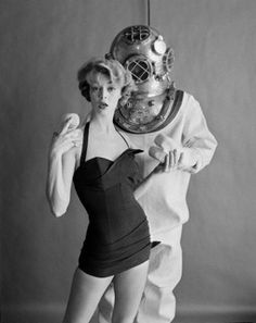 Jean Patchett poses in a swimsuit with a male model in an undersea diver's hardhat suit. Fashion advertisement for California Bathing Suits.... Image by © William Helburn/Corbis Mid 1950's New York