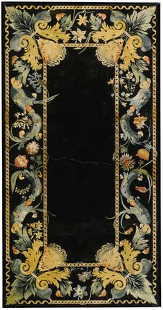 An Italian scagliola table top, 17th century of rectangular form with a ribbon banded border enclosing scrolling foliage and flowers including carnations, tulips, with satyr masks at the angles on a modern ebonised base with platform stretcher; top restored top: 131cm. x 67cm.; table: 58cm. high,136cm. wide, 69cm. deep; 4ft. 3½in x 2ft. 2½in. 1ft. 10¾in x 4ft. 5½in x 2ft. 3¼in.