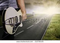 man with guitar walking through countryside - Google Search