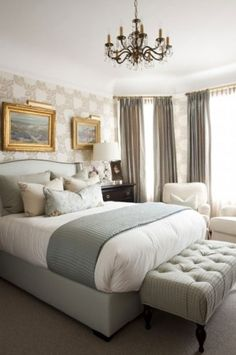 """serene silver & blue: Throw """"I think every bed needs a folded textile on the end—it's a finishing touch,"""" says Griffin. When folded, she adds, it should drop at least 6 to 12 inches on either side: """"If you have a queen-size bed, most standard throws will be too small. Instead, use a twin-size blanket. It's perfect."""""""