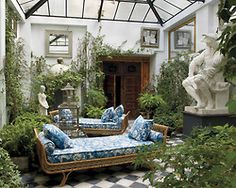 ladurees: enochliew: Home of Lorenzo Castillo 1960s Jansen daybeds upholstered in a Madeleine Castaing fabric, replica of a Michelangelo sculpture from a Paris flea market, and 19th-century Spanish doors. I want my home to be like this