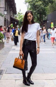 Liu Wen (with Louis Vuitton bag).  (2014)