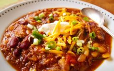 Nicely spiced chili strewn with succulent strands of pulled pork.
