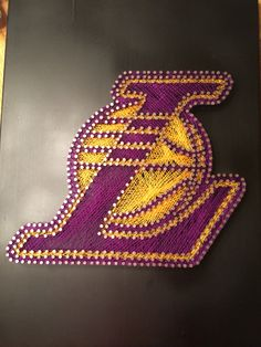 Los Angeles Lakers logo string art with matte black spray paint background. By Chris Brezic
