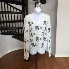 WILDFOX blue sweatshirt with black skulls WILDFOX blue sweatshirt with black skulls chic, comfy, and cozy. Perfect condition, gently used Wildfox Tops Sweatshirts & Hoodies