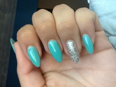 Tiffany blue with silver stiletto nails