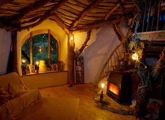 """""""Simon and his father-in-law built this hobbit house in just four months. Read more: Extraordinary Off-Grid Hobbit Home in Wales Only Cost three thousand pounds to Build Simondale Hobbit House – Inhabitat - Green Design Will Save the World Earthship, Casa Dos Hobbits, Woodland House, Forest House, House Trees, Woodland Bedroom, Woodland Theme, House Windows, Cob Houses"""