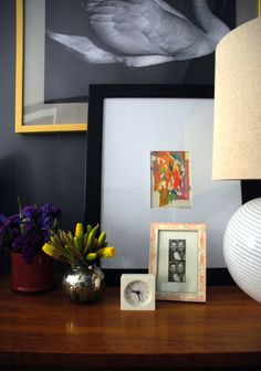 a small abstract pastel framed & paired with black/white photo art. NICE