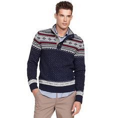 $90 Tommy Hilfiger men's sweater. Not your grandfather's Fair Isle sweater—ours is slimmer, lighter and tailor made for layering in a fine wool blend. • Classic fit.• 80% wool, 20% nylon.• Stand-up collar with half-button placket, ribbed trim, microflag at cuff.• Hand wash. • Imported.
