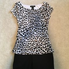 White House Black Market Top Short sleeve top - looks great with a pencil skirt!  Shirt is completely lined so it lays nicely on, very slimming. 95% rayon, 5% spandex. White House Black Market Tops