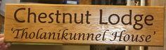 Oak Sign with brown lettering. http://www.sign-maker.net/wooden/oak-carved-signs.html
