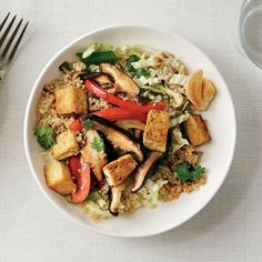 Asian Stir-Fry Quinoa Bowl Sesame oil, soy sauce, fresh ginger, and sliced napa cabbage give this stir-fry vibrant Asian flavor.