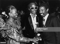 """Photo of Miles DAVIS and KOOL & THE GANG and Robert Kool BELL and Cicely TYSON; Robert Bell """"Kool"""" of Kool and The Gang greeting Cicely Tyson and husband Miles Davis at a party at the Palace. Get premium, high resolution news photos at Getty Images Black Actresses, Hollywood Actresses, Kool & The Gang, Big Band Leaders, Gone Girl, Walter White, Miles Davis, Jazz Musicians, Music Icon"""