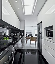 """love the dark shiny floor, and the """"built in microwave"""". I love that look more than it being in bouw. Like the matching dark counters and backsplash wall."""