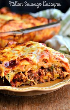 This lasagna is absolutely amazing! It's made with spicy Italian sausage, cooked with onions and peppers, and a mice mixture of cheeses.