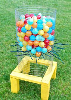 Your guests will lose their marbles (pun intended) over this game. For extra fun, swap out the plastic balls for water balloons. The first one to cause the bunch to drop gets to start the water balloon fight!  Learn how to make it on All Parenting.