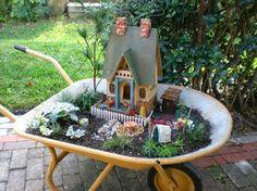 Mini jardín sobre carretilla