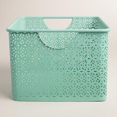 Lend a fresh look to the powder room or master bath with our aqua blue storage bin, crafted of punched metal in a filigree design. Pair it with our large Mia bin or rolling cart to create even more stylish storage for towels and toiletries.