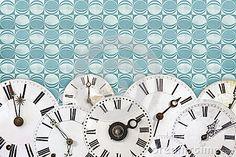 Set of vintage clock faces against a retro wallpaper background