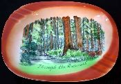 Redwoods Ashtray with six rests and no cracks. The ashtray was manufactured by SNCO and does have a tiny ding on the lip and underside. Otherwise, this ashtray is in mint condition.