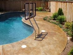 acid stained concrete and stone border around pool | h<3me