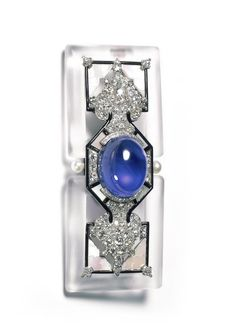 Cartier Brooch, 1924. Platinum, gold, diamonds, one sapphire cabochon (weighing approximately 57.60 carats), rock crystal. Pearls, mother-of-pearl, enamel
