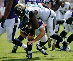 Jacksonville Jaguars defensive tackle Malik Jackson (90) sacks Baltimore Ravens quarterback Joe Flacco (5) during the first half of an NFL football game in Jacksonville, Fla., Sunday, Sept. 25, 2016.