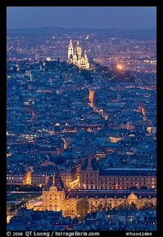 Aerial view with Louvre and Montmartre at night, Montmartre. Paris, France (color)