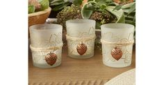 Leaf Print Copper Acorn Tea Light Holder (Set of 4)From your wedding tables to your Thanksgiving table, bring ambient light into the atmosphere with Kate Aspen's Leaf Print Tea Light Holder with Copper Acorn Charm! The soft frosted glass throws light from the tea lig