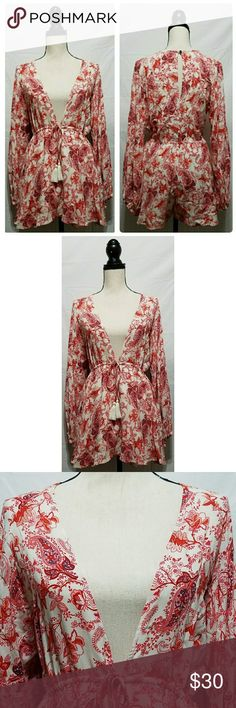 "Cotton Candy LA Ivory Red Paisley Boho Romper Junior's Cotton Candy LA romper, size small. It is ivory with a red paisley design, very low plunging neckline and long sleeves. It is brand new without tags.   100% rayon  Chest: 40"" Armpit to armpit: 20"" Length (shoulder to hem): 30"" Length  (armpit to hem): 21""  All items come from a smoke and pet free home. Cotton Candy LA Dresses"