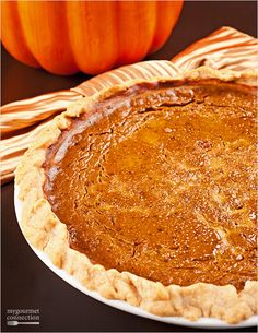 This lightly sweet, rum-spiked pumpkin pie is flavored with molasses and a generous amount of fragrant spices and topped with rum whipped cream.