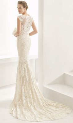 Elegant cap sleeve fitted lace wedding dress with simple bridal train; Featured Dress: Rosa Clara