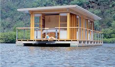 Arkiboat small houseboats design. I love this and feel it could have been made out of a container.