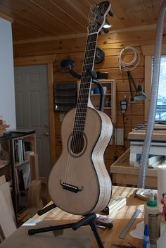 Photos and commentary on the construction of a romantic Lacote guitar from raw parts through completion
