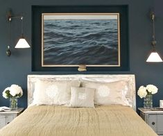 Dark blue walls and a photograph of the sea make this bedroom a sensuous retreat and a place to escape from the world. My bedroom has dark blue walls, now where can I find the picture?