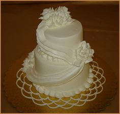 Mini Buttercream Wedding Cake With Buttercream Drape and Flowers