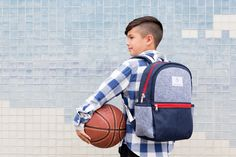 It's (almost!) time to get back to school, and our Kid's Backpacks, made in collaboration with STATE Bags, are perfect for every academic adventure! For each backpack made available on Honest.com, one will be hand-delivered to a child in need. | Honest Kid's Backpack in Navy, collaboration with STATE Bags