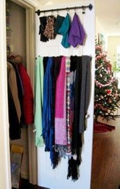 DIY a curtain rod into a closet organizer. great closet organization tip!