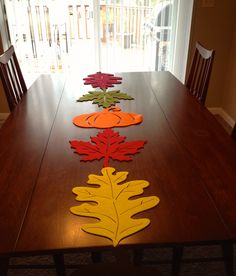 DIY fall table runner......felt leaves (I got them from Michael's) sewn together with fishing line :0)