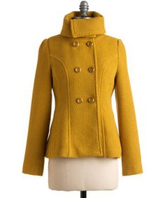 Style POP: A retro mustard color peacoat can be the statement piece worn with a simple pair of jeans.
